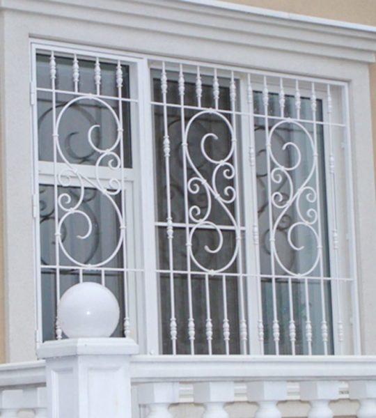 купить кованые решетки на окна в москве